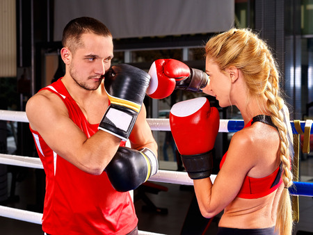 aerobic instructor: Couple Man and Woman Wearing Gloves Boxing in sport Ring. Martial art sport. Stock Photo