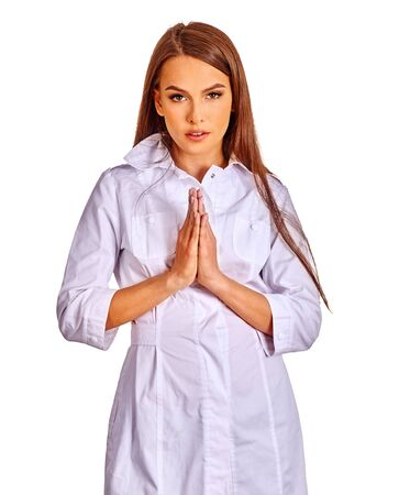 a lady doctor: Doctor hands folded in prayer. Female doctor on isolated. Doctor turning to God. Stock Photo