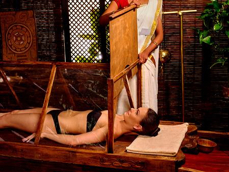 seminude: White seminude woman lie in sauna. Indian Ayurvedic sauna treatment. Indian woman sauna door closes.