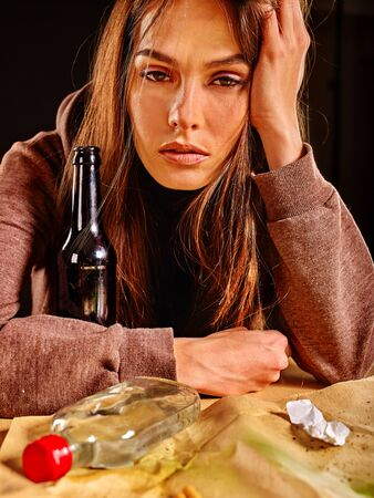 dipsomania: Girl in depression drinking bottle alcohol in solitude. Drinking habits. Girl is heavy alcohol drinkers. Stock Photo
