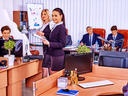 printing out: Happy group business people in office. Business woman is printing out. Stock Photo