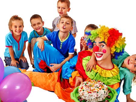 birthday clown: Birthday clown with group children keeps birthday cake .Celebration of children birthday . Isolated. Stock Photo