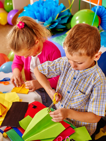 Group children do origami airplane in primary school. Origami lesson in primary school. Stock Photo