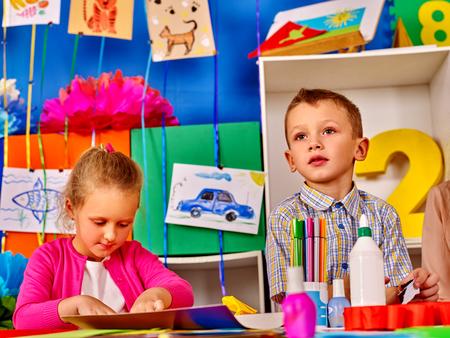 sculp: Boy and girl children mold from plasticine in school. Children in primary school. Development of childrens creativity.