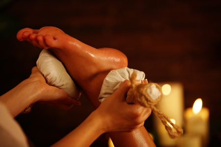 Poultice massage herbal poultice foot. Therapy with Thai Reflexology for foot. Stock Photo