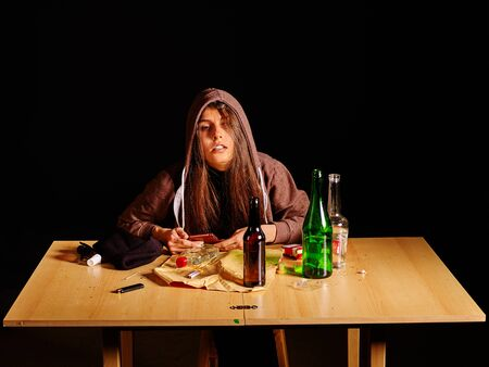 drinking problem: Girl in depression drinking alcohol and smokes cigarettes in solitude. Drinking habits. Girl is heavy drinkers. Stock Photo