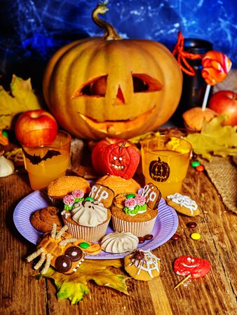 Halloween table with trick or treat. Carving Halloween Jack OLanten pumpkin.