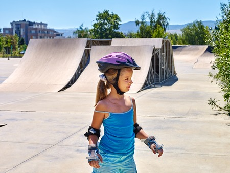 blading: Sport girl riding on roller skates in skatepark. Summer sport park. Stock Photo