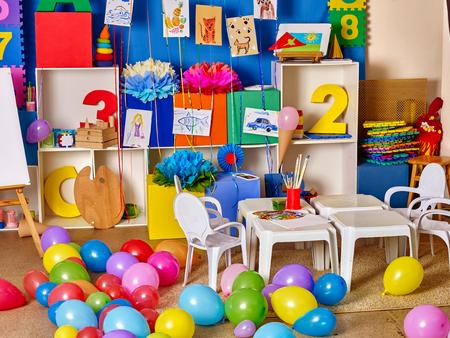 game room: Interior of game room in preschool kindergarten. A lot of balloons on floor. Stock Photo