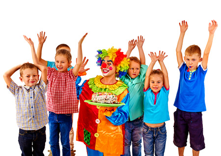 keeps: Clown keeps birthday cake with group children hands up. Isolated.