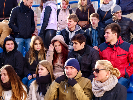 sports fans: Disappointed fans on tribune. Loss of their favorite team. Sport fans Unhappy group people fans . Stock Photo