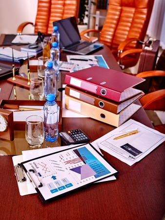 office life: Business still life with stationery on table in office. On business table laptop. Stock Photo