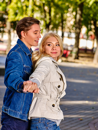 gay girl: Young couple gay and girl dancing and flirting in autumn park . Love in autumn park.