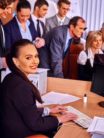 group of business people: Happy group business people in office. Business woman looks on monitor on foreground. Stock Photo