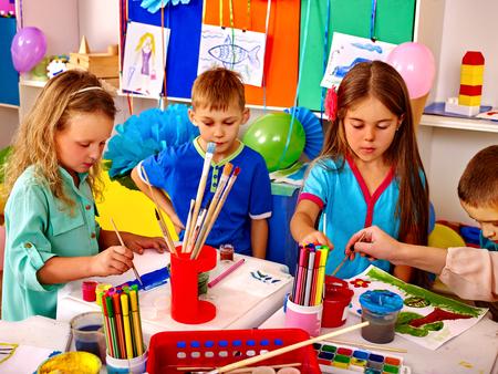 children painting: Group children learn painting in kindergarten. Happy childhood. Stock Photo