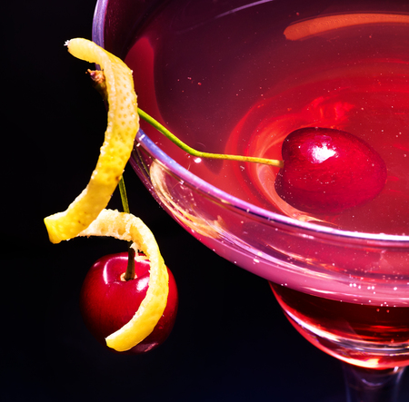 Part of cherry cocktail with lemon slice decoration in martini glass . Top view. Stock Photo