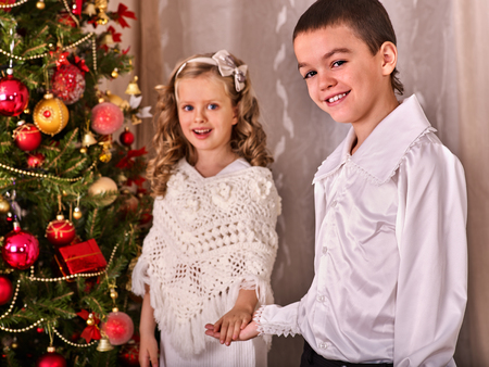 children receiving gifts under christmas tree black and white retro brother and sister home - Home Alone White Christmas