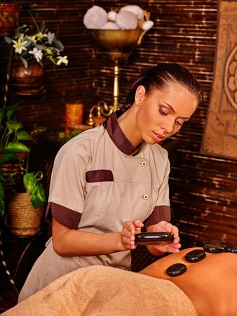 lastone therapy: Man having massage . Man have stone massage. Stone massage therapy for man . Lastone massage therapy.