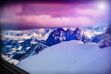 pink skies: Winter mountains Switzerland in sunshine. Nature landscape. Mountainside and deep snow.