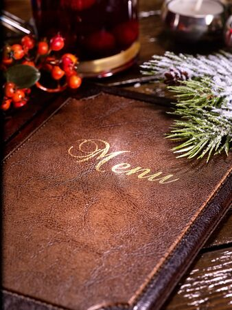 punch spice: Menu on restaurant table. On background tea mug decorated berries. Spruce branch for decoration. Stock Photo