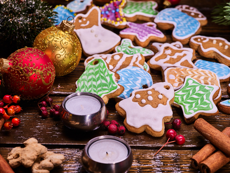 woden: Christmas gingerbread cookies on woden table and candels. Stock Photo