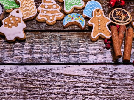 woden: Christmas gingerbread cookies on woden table and candels. Background with copy spice Stock Photo