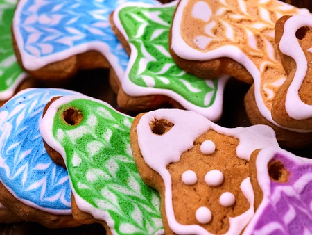 set of colored cookies close up gingerbread christmas trees and stars stock photo
