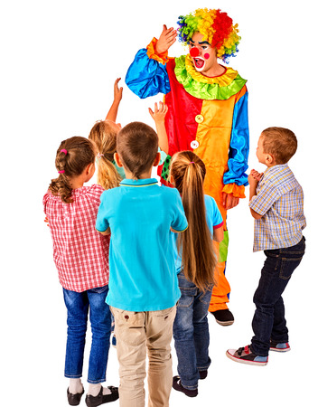 Childrens party entertainers. Birthday child clown playing with children. Kid holiday cakes celebratory in hands of events organizer man. Fun of group people pose for camera on white background. Stock Photo