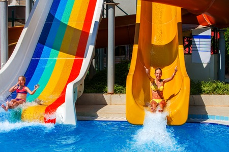 Swimming Pool Slides For Children On Water Slide At Aquapark Stock