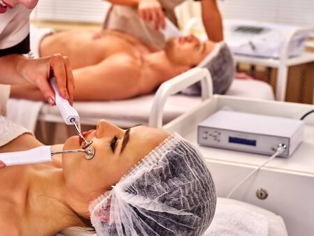 nu: Spa days for 2 . Couple facial massage beauty salon. Electric stimulation woman and man skin care . Professional equipment microcurrent lift face. Anti aging rejuvenation and non surgical treatment.