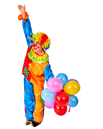 Birthday child clown in wig and costume with balloons bunch on isolated. Events organizer man hand up on white background .