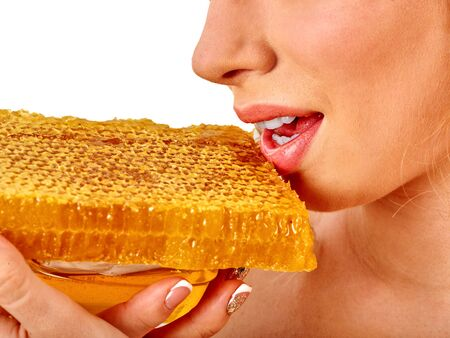 Facial honey mask for woman lips. Honeycombs natural homemade organic threatment. Skincare by face and health concept on isolated.