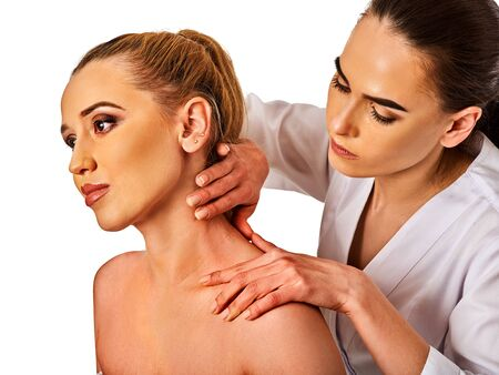 spa therapy: Shoulder and neck massage for woman in spa salon. Doctor making neck therapy in rehabilitation center on isolated.