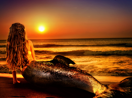 undine: Water nymph mermaid woman dreams on sea sandy beach. Fairy nixie girl looks at tropical setting sun. Fantasy sunset painted undine, sky and sea waves in gold. Magical fish tail of naiad shining squama