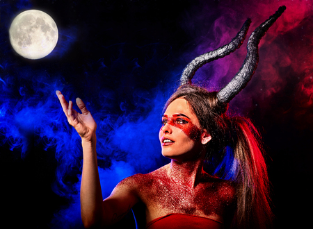Black magic ritual of mad satan woman cry in hell. Halloween witch reincarnation mythical creature on Sabbath. Night sky , moon with fog. Mythical zodiac Horoscope Capricorn Aries , Taurus astrology.