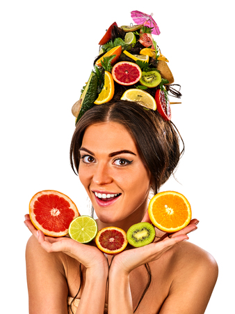 Hair mask from fresh fruits on woman head. Girl with beautiful face hold ingredient for homemade organic skin and hair therapy. Fruits are nicely laid out on palms. Concept of healthy and beauty .