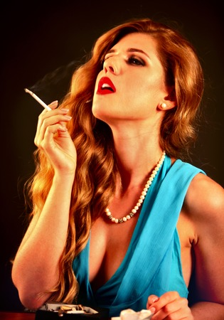 Girl with proud and independent who smokes cigarette. Stock Photo