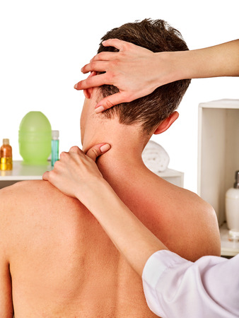 salon and spa: Shoulder and neck massage for woman in spa salon. Doctor making therapy in rehabilitation center . Reinforcement of joint in good clinic. Back view. Elimination of consequences of sports injuries. Stock Photo