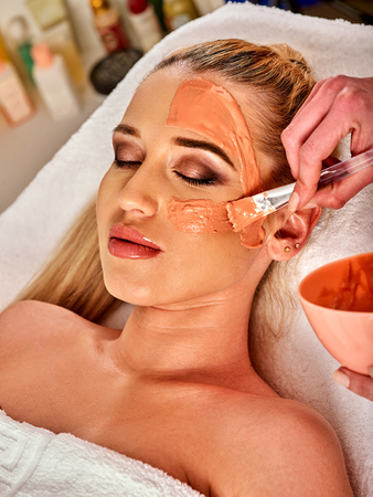 Collagen face mask. Facial skin treatment. Face of woman receiving cosmetic procedure in beauty salon close up . Paraffin mask for skin. Stock Photo