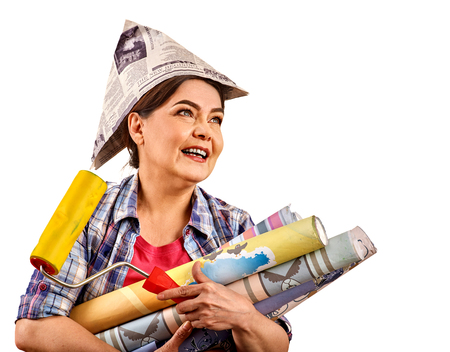 Repair home elderly woman holding paint roller for wallpaper. Happy senior woman in newspaper cap renovation apartment and calling for help on isolated.