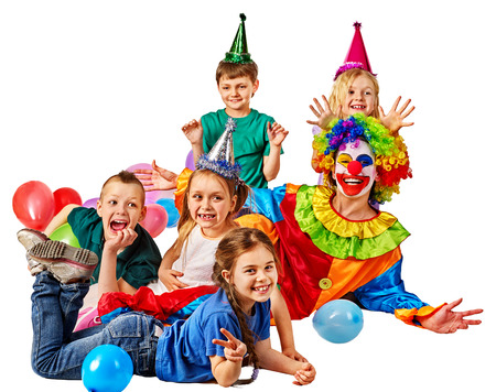 Birthday child clown playing with children and bunny fingers prank. Kid holiday cakes celebratory and balloons happiest day. Children at a childrens matinee. Holiday for kids in kindergarten.