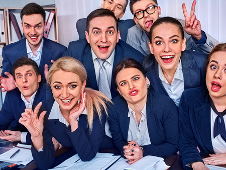 Mad business people office in high school celebrate successful passing exams. Team student college rejoice project. Men and women fooled to give bunny fingers prank. Group of graduates making selfie. Stock Photo