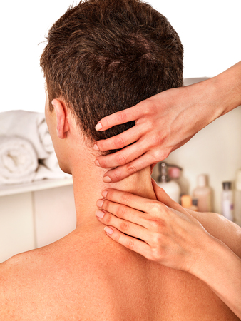 back ache: Shoulder and neck massage for man in spa salon. Doctor making neck therapy in rehabilitation center. Repositioning of joint in clinic. Correction of dislocation of neck by experienced specialist.