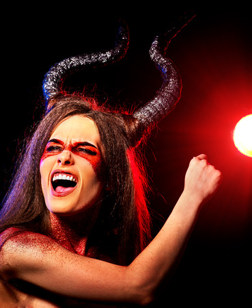 hellfire: Black magic ritual of mad satan woman cry in hell on Halloween. Devil absorbing soul. Mythical zodiac Horoscope Capricorn Aries, Taurus astrology. Visions of drug addict.