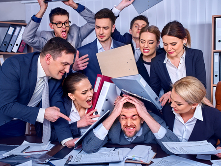 Business people office. Team people are unhappy with their leader. Intern man manager does not cope with his duties. Crowd in stress throw up their chiefs papers New employee on the first working day Stock Photo - 82919142