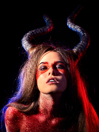 Mad satan woman on black magic ritual of hell. Witch reincarnation mythical creature Sabbath. Devil absorbing soul Halloween. Astral travel. Make-up for night club for demon inflicts damage. Stock Photo