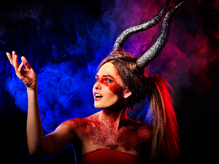 hellfire: Mad satan woman on black magic ritual of in hell. Witch reincarnation mythical creature on Sabbath. Devil on Halloween. Astral beings are among us. Make-up for night club. Visions of drug addict.