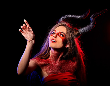 Mad satan woman on black magic ritual of hell. Witch reincarnation mythical creature Sabbath. Devil absorbing soul Halloween. Astral entities. Make-up for night club for demon inflicts damage. Stock Photo