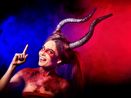 hellfire: Mad satan woman on black magic ritual of in hell . Witch reincarnation mythical creature on Sabbath. Devil absorbing soul on Halloween. Mythical zodiac Horoscope Capricorn Aries. Astral travel.