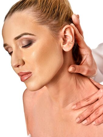 luxacion: Shoulder and neck massage for woman in spa salon. Doctor making neck therapy in rehabilitation center on isolated. Reduction of dislocation.